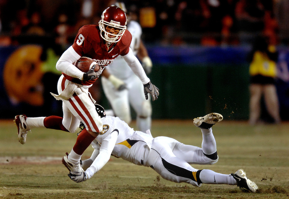 Missouri safety Hardy Ricks grabs onto the shoe of OU WR Juaquin Iglesias for a tackle in the second half.