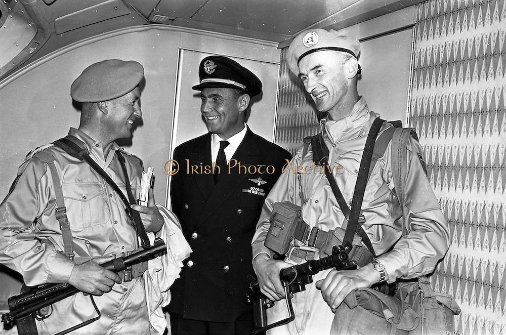 24/10/1962<br /> 10/24/1962<br /> 24 October 1962<br /> 38th Battalion advance party leave for the Congo for United Nations duty. the advance party of the 38th battalion and the 2nd Armoured Squadron left Dublin Airport for the Congo by specially chartered Sabena 707 Boeing jet. The 150 troops would arrive in the Congo the next day. Picture shows Commandant Donal O'Donovan (left), Tralee, of the 38th Battalion chatting to Captain L.W. Thorne, Captain of the Sabena jet and Commandant Kevin Nunan (left), Ardfert, Co. Kerry who was in charge of the troops on board. Commandant Nunan later won the Distinguished Service Medal With Honour in the Congo for bravery in rescuing Trooper Nolan from drowning in the Mulangwoshi river.