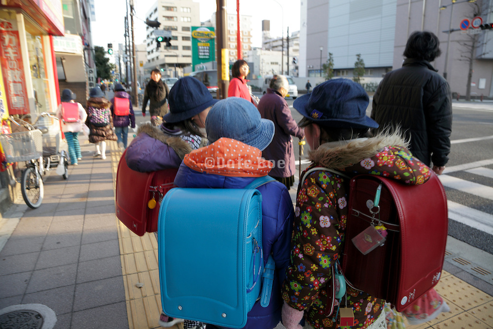 Japan casual dressed school children with backpack