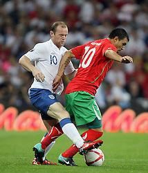 04.09.2010, Wembley Stadium, London, ENG, UEFA Euro 2012 Qualification, England v Bulgaria, im Bild Action involving Wayne Rooney of England and Valeri Bojinov of Bulgaria. EXPA Pictures © 2010, PhotoCredit: EXPA/ IPS/ Marcello Pozzetti +++++ ATTENTION - OUT OF ENGLAND/UK +++++ / SPORTIDA PHOTO AGENCY