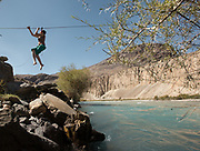 Crossing a river on a Zip-line between Savnob village and Barchadev.