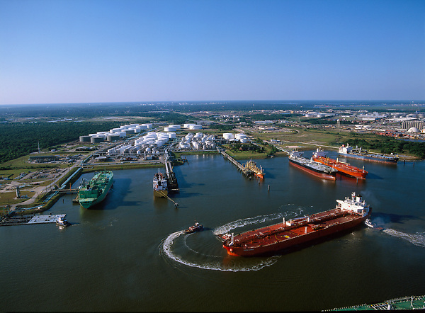 Aerial view of a tanker being guided through the Port of Houston