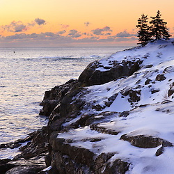 Dawn over the Atlantic Ocean in winter as seen from near Schooner Head on Maine's Acadia National Park.