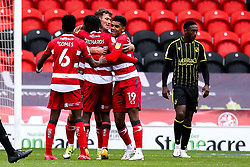Joe Wright of Doncaster Rovers celebrates with teammates after scoring a goal to make it 1-0 - Mandatory by-line: Robbie Stephenson/JMP - 26/09/2020 - FOOTBALL - The Keepmoat Stadium - Doncaster, England - Doncaster Rovers v Bristol Rovers - Sky Bet League One