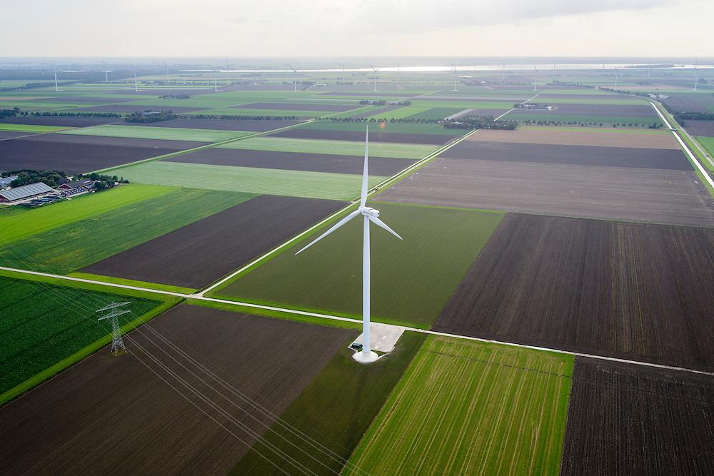 Nederland, Flevoland, Zeewolde, 10-10-2014; Hoogspanningsmasten en windturbine. Prinses Alexia windpark, voorheen windpark De Zuidlob. Het windmolenpark is een initiatief van lokale boeren en Nuon - Vattenfall. <br /> Prinses Alexia wind farm. The wind farm in the polder Flevoland is an initiative of local farmers and Nuon - Vattenfall.<br /> luchtfoto (toeslag op standard tarieven);<br /> aerial photo (additional fee required);<br /> copyright foto/photo Siebe Swart