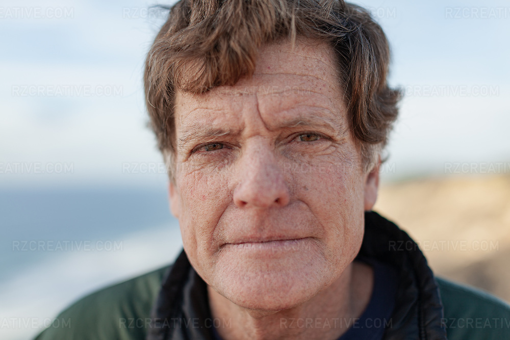 Portrait of paddler Ed Gillet in La Jolla, Calif. Ed Gillet is the only person who successfully kayaked the distance from Monterey, CA to Maui, HI. Gillet, who in 1987 set off on a solo, self-supported kayak expedition from Montereyused a stock Necky Tofino kayak loaded with 600 pounds of food and gear. Gillet self-propelled his boat using only a sextant to navigate the 2,200 mile journey across the Pacific.Amazingly, 64 days later, he arrived safely and lived to tell of his incredible feat. Photo © Robert Zaleski / rzcreative.com<br /> —<br /> To license this image contact: robert@rzcreative.com