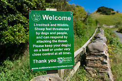 Sign on public footpath warning to keep dogs under control at Pease Bay James Hutton Walk in Berwickshire, Scotland, UK