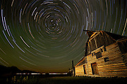 NEWS&GUIDE PHOTO / PRICE CHAMBERS<br /> This composite image combines 16 time exposures to record the night sky above a barn near Mormon Row in Grand Teton National Park Thursday morning. The North Star, Polaris can be seen at the center of the star trails. The brightest star in the constellation Ursa Minor, it is actually six stars orbiting each other about 430 light years from Earth. Due to its nearly perfect alignment over the North Pole, it has helped people navigate for hundreds of years.
