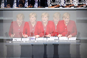 A multiple exposure image of German Chancellor Angela Merkel addresses latest developments in Afghanistan during a session at Germany's lower house of parliament the Bundestag  in Berlin, Germany, August 25, 2021. Among the issues discussed was the deployment of the German Armed Forces, Bundeswehr to oversee the evacuation from Afghanistan.