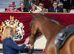 Queen Elizabeth II (left) watches her horse Barbers Shop, who is retiring, during the Royal Windsor Horse Show at Windsor Castle, Berkshire.