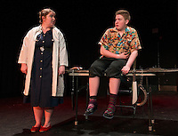 Dr. Fritz (Kate Persson) examines Tom (Shawn Zappala) at his doctor's visit during dress rehearsal for Dr. Fritz at Laconia High School on Thursday afternoon.  (Karen Bobotas/for the Laconia Daily Sun)