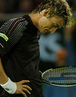MELBOURNE, AUSTRALIA - JANUARY 30: A dejected Juan Carlos Ferrero during day 12 of the Australian Open January 30, 2004 in Melbourne, Australia. (Photo by Sportsbeat) *** Local Caption *** -
