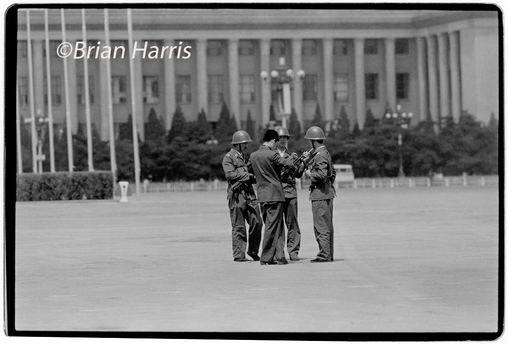 China_Beijing in 1989. Chinese army troops occupy positions on Tiananmen Square in the centre of Beijing a week after the massacre of student protesters in June 1989<br /> Photographs of Chinese army and security personel gurding the area in and around Tiananmen Square, taken secretly from inside a blacked out taxi as photographers were under threat of being arrested if they worked openly in the area around Tiananmen Square after the massacre.<br /> Wikipeadia: The Tiananmen Square protests of 1989, commonly known in mainland China as the June Fourth Incident (六四事件), were student-led demonstrations in Beijing, the capital of the People's Republic of China, in 1989. More broadly, it refers to the popular national movement inspired by the Beijing protests during that period, sometimes called the '89 Democracy Movement (八九民运). The protests were forcibly suppressed after Chinese Premier Li Peng declared martial law. In what became known in the West as the Tiananmen Square Massacre, troops with automatic rifles and tanks fired at the demonstrators trying to block the military's advance towards Tiananmen Square. The number of civilian deaths has been estimated variously from 180 to 10,454.