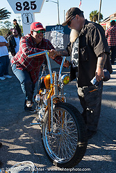 Willie chats with Ray Llanes at his annual Tropical Tattoo Old School Bike Show during Daytona Bike Week. FL, USA. March 13, 2014.  Photography ©2014 Michael Lichter.