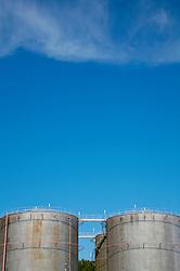 Industrial storage tanks against blue sky