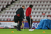 Football - 2019 / 2020 Premier League - AFC Bournemouth vs. Liverpool<br /> <br /> Bournemouth's Nathan Ake crosses the pitch on crutches after the match at the Vitality Stadium (Dean Court) Bournemouth <br /> <br /> COLORSPORT/SHAUN BOGGUST