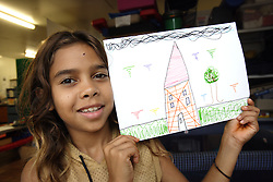 attends the Save the Children Australia's Chilling Space program  in Kununurra, Western Australia.  The Chilling Space provides a safe place for children to come to every night for supervised activities and fun with other children in the community.