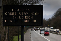 © Licensed to London News Pictures. 19/12/2020. London, UK.  A traffic matrix sign on the London bound A3 says 'COVID-19 CASES VERY HIGH IN LONDON PLS BE CAREFUL'. Government ministers are reported to be discussing extra measures to stop the increase in Covid-19 cases in the south east. Photo credit: Peter Macdiarmid/LNP