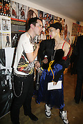 Piers Atkinson and Namalee. i-Dentity opening. Celebrating 25 years of i-D. Fashion and Textile magazine. Ber5mondsey St. London. SE1. 13 October  2005. ONE TIME USE ONLY - DO NOT ARCHIVE © Copyright Photograph by Dafydd Jones 66 Stockwell Park Rd. London SW9 0DA Tel 020 7733 0108 www.dafjones.com