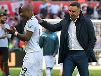 Football - 2017 / 2018 Premier League - Swansea City vs. Stoke City<br /> <br /> Swansea City manager Carlos Carvalhal leaves the field with André Ayew of Swansea City as Swansea lose & are relegated, at The Liberty Stadium.<br /> <br /> COLORSPORT/WINSTON BYNORTH