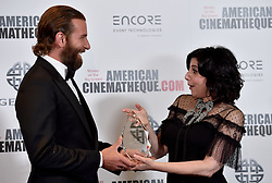Sue Kroll and Bradley Cooper attend the 30th Annual American Cinematheque Awards Gala at The Beverly Hilton Hotel on October 14, 2016 in Beverly Hills, California. Photo by Lionel Hahn/AbacaUsa.com