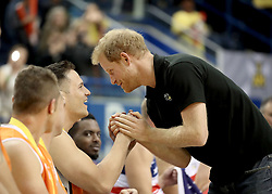 Prince Harry congratulates the competitors at the wheelchair basketball at the Mattamy Athletic Centre at the 2017 Invictus Games in Toronto, Canada.