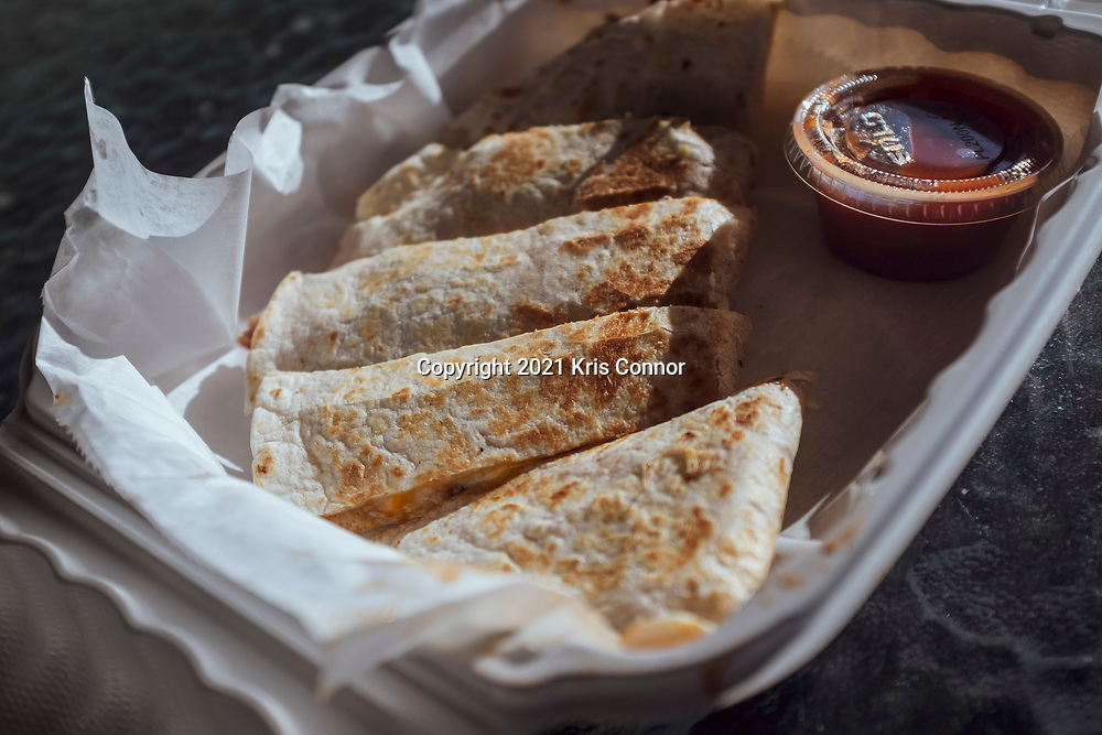 Pork Quesadilla by Royal Elite BBQ during Food Truck Fridays in  Levittown, New York on March 26th, 2021. Photo by Kris Connor