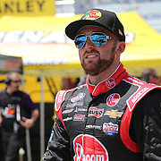 Sprint Cup Series driver Austin Dillon (3) walks down pit row during the 57th Annual NASCAR Coke Zero 400 race first practice session at Daytona International Speedway on Friday, July 3, 2015 in Daytona Beach, Florida.  (AP Photo/Alex Menendez)