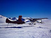 Lake Clark Air Service's Cessna 180 on wheel skis departing the Bonanza Hills Strip following mishap with de Havilland DHC3 Otter, Alaska.