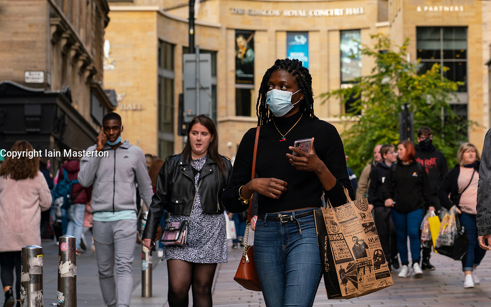 Glasgow, Scotland, UK. 25 September, 2020. As the threat of a second wave of Covid-19 cases increases , members of the public go about their business in Glasgow city centre today.  Pictured; Shoppers on Buchanan Street wearing facemasks.  Iain Masterton/Alamy Live News