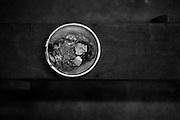 """French guyana, maripasoula, maroni.<br /> <br /> Pole economique du Haut-Maroni pour certains, tiers-monde de la republique pour d'autres. <br /> Plus vaste """"commune"""" de France : 3 600 habitants sur un rayon de 150 kilometres, coincee entre la foret amazonienne et le Maroni, fleuve frontiere du Surinam. A l'exception des services departementaux et municipaux, l'orpaillage avec ses metiers derives represente la seule source d'activite. Comptoir d'achat d'or. Paillettes d'or, une cinquantaine de grammes au cours local fluctuant autour de 8 euros le gramme."""