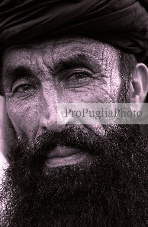 Khost, 20 August 2005..Portrait of Afghan man wearing a black turban