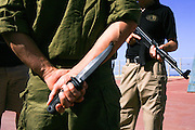 """Soldiers train with Krav Maga (""""contact combat"""", """"close combat"""" or """"full contact"""") is an eclectic hand-to-hand combat system developed in Israel that involves wrestling, grappling and striking techniques) at an Israeli military training camp. Attacker has a concealed knife"""