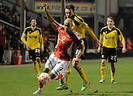 Adam chambers battles for possession during the Sky Bet League 1 match between Walsall and Sheffield Utd at the Banks's Stadium, Walsall, England on 17 March 2015. Photo by Alan Franklin.
