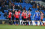 Didier Ndong of Sunderland (l) is shown red card and sent off by referee Andrew Madley after a bad tackle/foul on Junior Hoilett of Cardiff city (on ground right).EFL Skybet championship match, Cardiff city v Sunderland at the Cardiff city stadium in Cardiff, South Wales on Saturday 13th January 2018.<br /> pic by Andrew Orchard, Andrew Orchard sports photography.