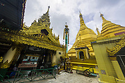 12 JUNE 2013 - YANGON, MYANMAR: Sule Pagoda in Yangon, Myanmar. Sule Pagoda is one of the city's oldest and most revered Buddhist temples and landmark for central Yangon.        PHOTO BY JACK KURTZ