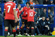 Marouane Fellaini of Manchester United celebrates with Wayne Rooney, the Manchester United captain and James Wilson of Manchester United after scoring his teams first goal of the game to make it 1-0. Barclays Premier league match, Queens Park Rangers v Manchester Utd at Loftus Road in London on Saturday 17th Jan 2015. pic by John Patrick Fletcher, Andrew Orchard sports photography.