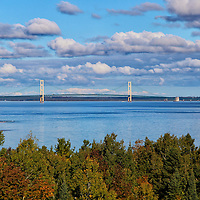 """""""Measured Distance""""<br /> <br /> From high above the trees, you get a wonderful view of the Mackinac Bridge in the straits of Mackinac!<br /> Gorgeous blue water and skies dotted with puffy clouds complete the image!!<br /> <br /> The Great Lakes by Rachel Cohen"""