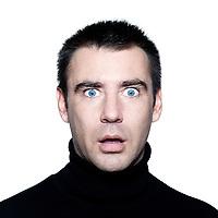 caucasian man portrait expressing  stun surprised startle portrait  on studio isolated white background