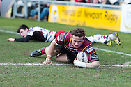 Hallam Amos of the Newport Gwent Dragons scores his second try of the game. Guinness Pro12 rugby match, Newport Gwent Dragons v Edinburgh Rugby at Rodney Parade in Newport, South Wales on Sunday 27th March 2016.<br /> pic by  Simon Latham, Andrew Orchard sports photography.