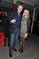 HUGO BURNAND and the MARCHIONESS OF MILFORD HAVEN at a party to celebrate the launch of the new Vertu Constellation phone - the luxury phonemakers first touchscreen handset, held at the Farmiloe Building, St.John Street, Clarkenwell, London on 24th November 2011.