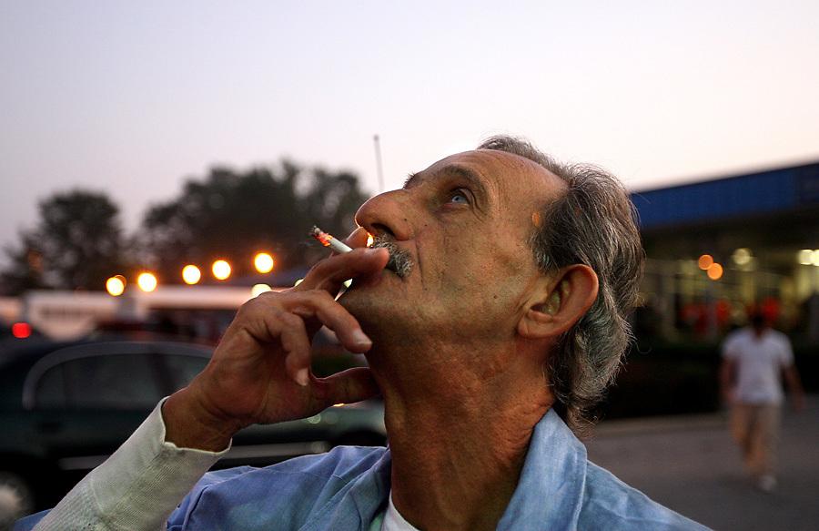 """Pop"" enjoys his first cigarette as a free man."