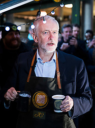 © Licensed to London News Pictures. 14/12/2017. London, UK. Labour Leader JEREMY CORBYN joins workers on the Change Please coffee cart in Borough Market which supports people out of homelessness. Photo credit: Rob Pinney/LNP