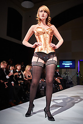 © Licensed to London News Pictures.  05/11/2014. OXFORD, UK. Oxford Fashion Week SS15 Lingerie Show at the Malmaison Hotel in Oxford. <br /> <br /> In this picture: Model wearing a copper corset created by ex Formula One engineer turned designer Jon Harris. Each corset has to be custom made to the model's exact measurements.  <br /> <br /> Photo credit: Cliff Hide/LNP