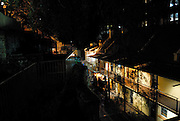 Elevated night-time view over The Rocks area from Foundation Park. This park contains the excavated ruins of 8 houses built into the cliff face between 1874 and 1880. The Rocks, Sydney, Australia