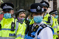An activist is arrested by Metropolitan Police officers opposite the UK headquarters of Elbit Systems, an Israel-based company developing technologies used for military applications including drones, precision guidance, surveillance and intruder-detection systems, on 11th May 2021 in London, United Kingdom. Activists were protesting against the company's presence in the UK and in solidarity with the Palestinian people following attempts at forced evictions of Palestinian families in the Sheikh Jarrah neighbourhood of East Jerusalem, the deployment of Israeli forces against worshippers at the Al-Aqsa mosque during Ramadan and air strikes on Gaza which have killed several children.