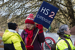 Uxbridge, UK. 1 February, 2020. Environmental activists from Stop HS2, Save the Colne Valley and Extinction Rebellion campaigning against the controversial HS2 high-speed rail link prepare to begin a 'Still Standing for the Trees' march from the Harvil Road wildlife protection camp in Harefield through Denham Country Park to three addresses closely linked to Boris Johnson in his Uxbridge constituency. The Prime Minister is expected to make a decision imminently as to whether to proceed with the high-speed rail line.