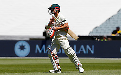 Australia's David Warner returns to the crease after his dismissal was overturned due to a no ball while he was on 99 runs during day one of the Ashes Test match at the Melbourne Circket Ground, Melbourne.