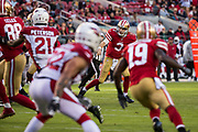 San Francisco 49ers quarterback C.J. Beathard (3) throws the ball off his teammate during the final minutes of gameplay against the Arizona Cardinals at Levi's Stadium in Santa Clara, Calif., on November 5, 2017. (Stan Olszewski/Special to S.F. Examiner)