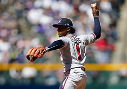 April 8, 2018 - Denver, CO, U.S. - DENVER, CO - APRIL 08: Atlanta Braves Infielder Ozzie Albies (1) makes a play to first base for an out during a regular season MLB game between the Colorado Rockies and the visiting Atlanta Braves on April 8, 2018 at Coors Field in Denver, CO. (Photo by Russell Lansford/Icon Sportswire) (Credit Image: © Russell Lansford/Icon SMI via ZUMA Press)
